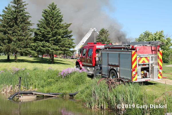 fire engine drafting from a pond