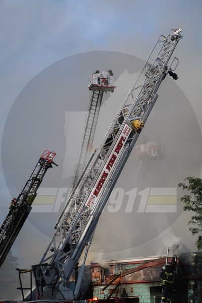 aerial ladders at work at fire scene