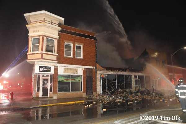 fire destroys commercial buildings