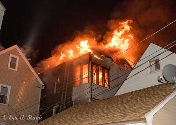massive flames engulf second floor of house