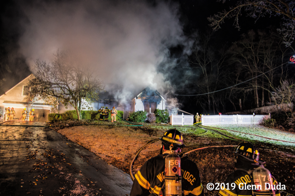heavy smoke from house fire at night