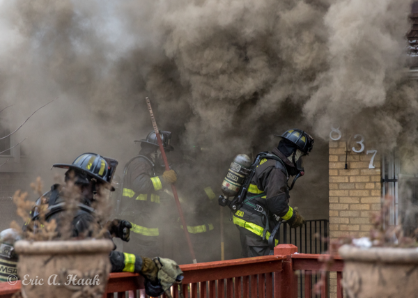Firefighters enter house with heavy smoke