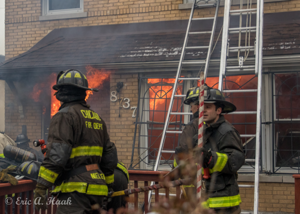 Firefighters at fire with flames