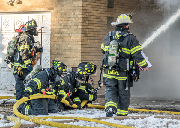 Firefighters with big hose line