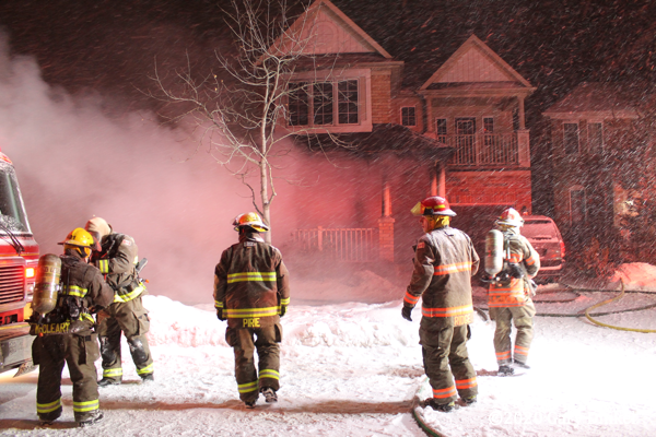 Cambridge Firefighters battle winter house fire at night