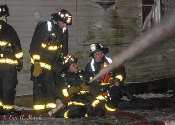 Firefighter mentors candidates at fire scene