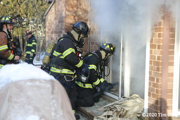 Firefighters battle a basement fire