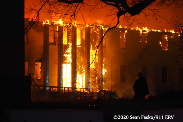 building engulfed by fire at night