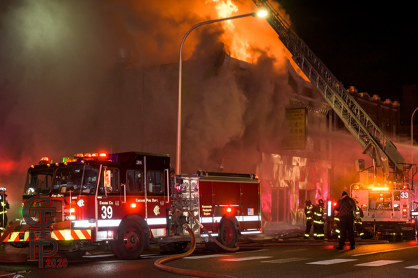 heavy fire engulfs building at night