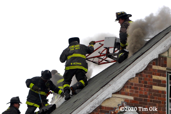 Chicago Firefighters on house roof