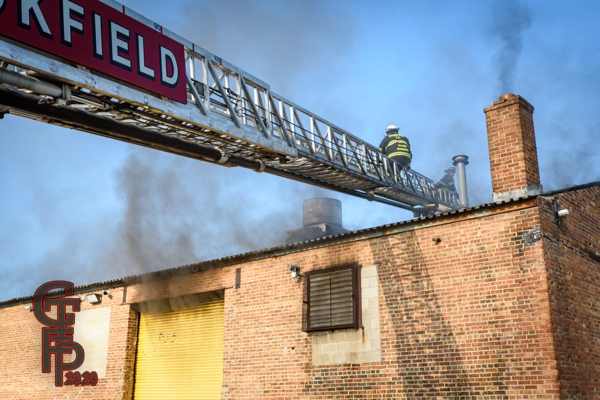Firefighter on E-ONE aerial ladder