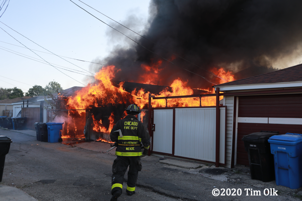 alley garage engulfed by fire