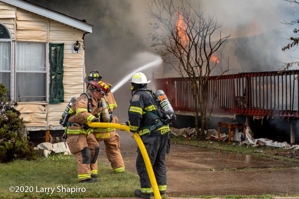 Firefighters use a 2 1/2 inch hand line at a fire