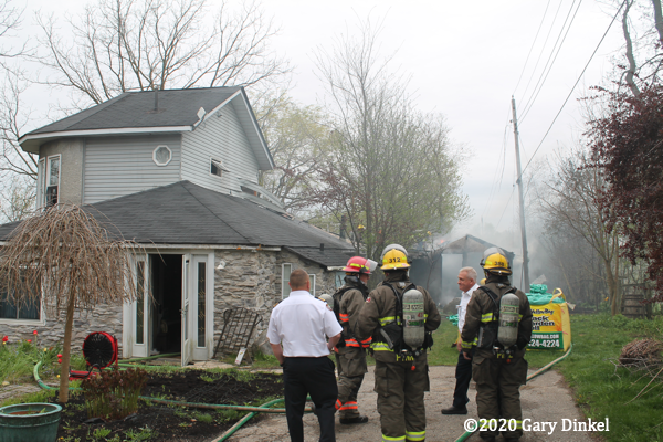 Firefighters in Canada at house fire scene