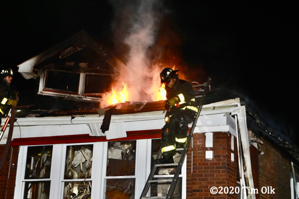flames through roof of house on fire
