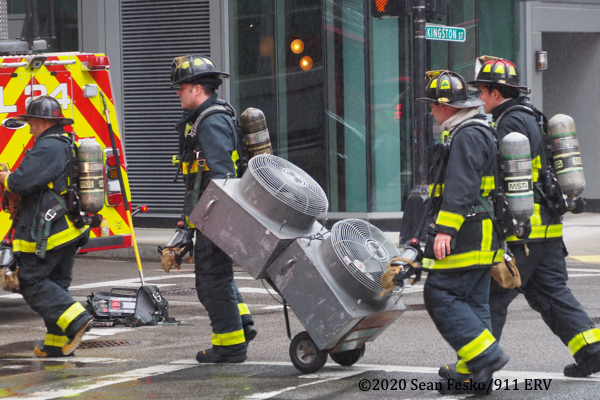 Boston Firefighters at the scene of a car fire in an underground garage 7/1/2