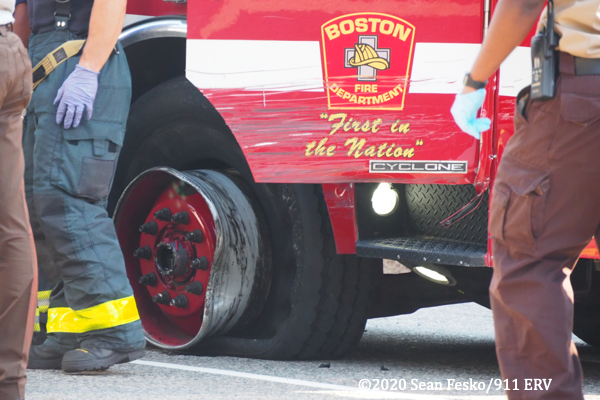 crash scene in Boston involving a fire truck