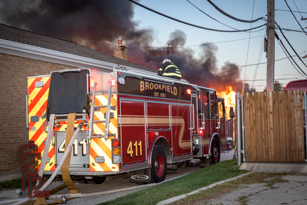 Firefighters battle garage fire with deck gun