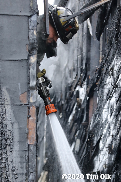 Chicago Firefighter with hose line