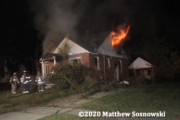 flames from a vacant dwelling in Flint Michigan
