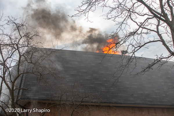 building fire with mansard roof