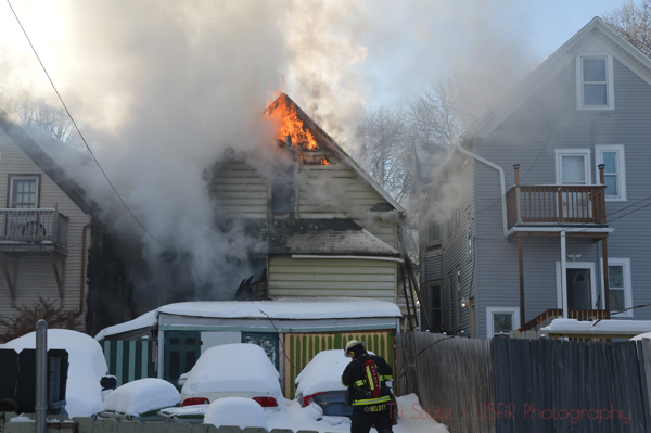smoke and flames from house on fire