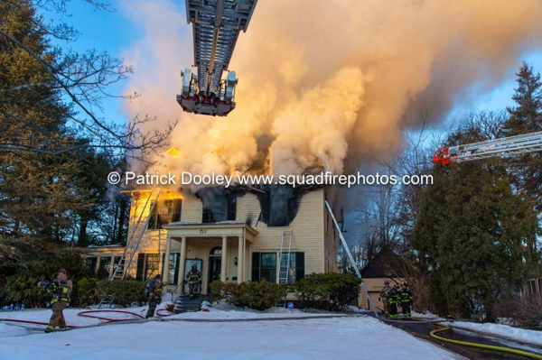 heavy smoke from large house on fire