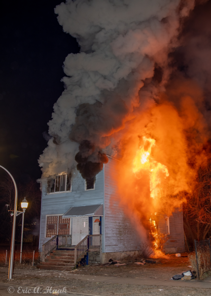house completely engulfed by fire at night