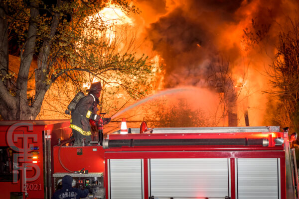 Detroit Firefighters battle fire in a house fully engulfed by flames