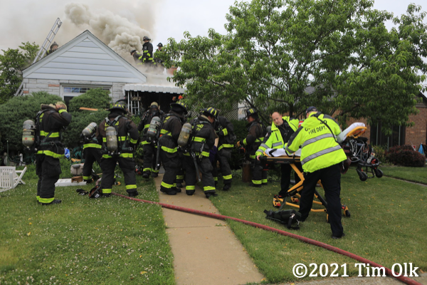 paramedics receive fire victim pulled from a house