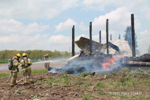 firefighters at rural fire scene