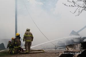 firefighters at barn fire