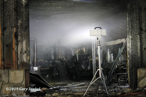 aftermath of garage fire that destroyed antique tractor