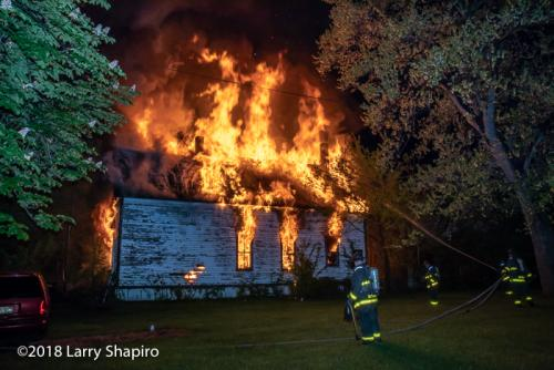 house engulfed in flames at night