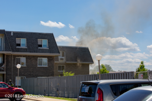 light smoke from apartment building fire