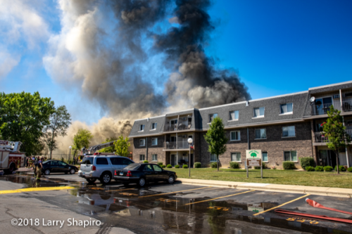 heavy smoke and huge header from building fire