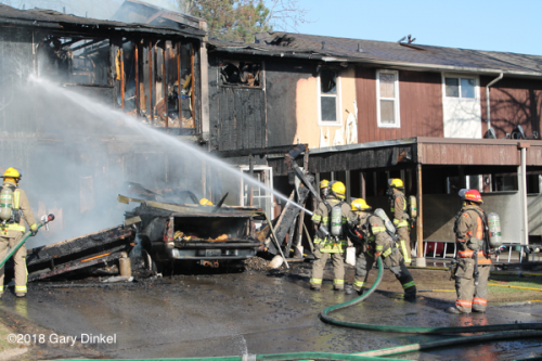 Firefighters overhaul after townhouse fire