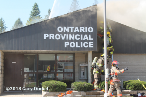 Firefighters battle fire in OPP building