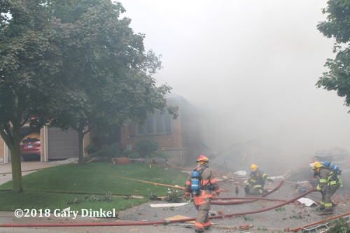 Firefighters at the scene of a fatal house explosion