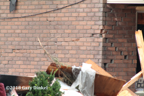brick structure damage after house explosion