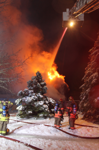 house engulfed in fire at night