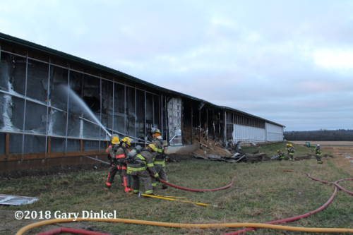 Canadian Firefighters battle a barn fire in Wilmot Ontario