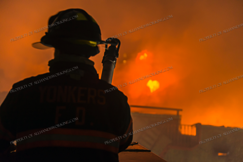 Firefighter silhouette at fire