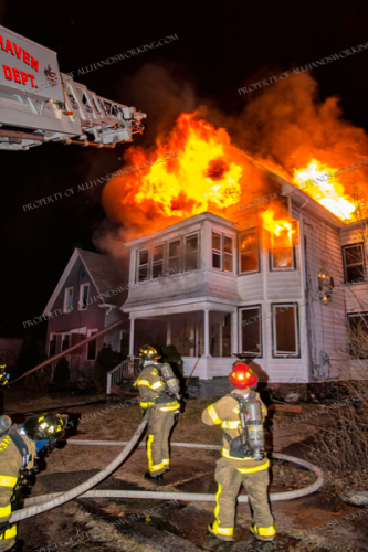 heavy flames and smoke from house on fire at night