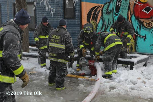 Firefighters struggle with hose frozen to hydrant