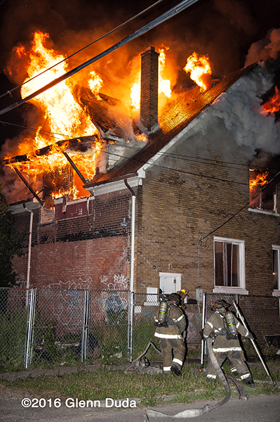 vacant dwelling gutted by fire in Detroit at night
