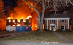 house under renovation engulfed by fire