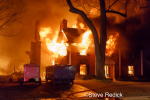 house engulfed by fire at night