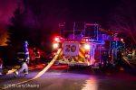 Pierce aerial ladder deploying at fire scene