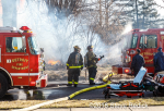 Firefighters cools fire engine at scene